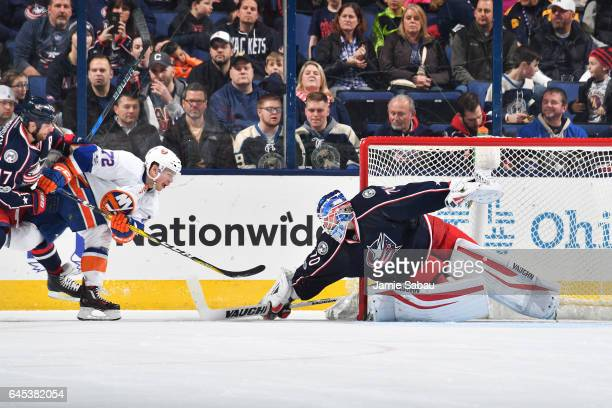 Goaltender Joonas Korpisalo of the Columbus Blue Jackets blocks a shot taken by Anthony Beauvillier of the New York Islanders during the third period...