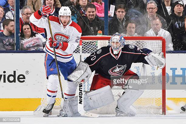 Goaltender Joonas Korpisalo of the Columbus Blue Jackets defends the net as Alex Galchenyuk of the Montreal Canadiens skates by on January 25 2016 at...