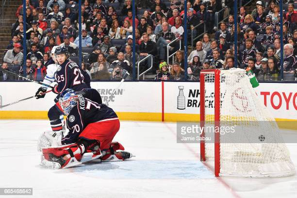 Goaltender Joonas Korpisalo of the Columbus Blue Jackets fails to stop a shot during the second period of a game against the Winnipeg Jets on April 6...