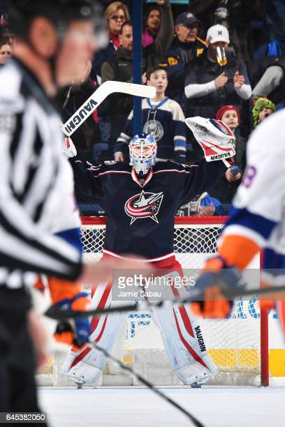 Goaltender Joonas Korpisalo of the Columbus Blue Jackets reacts after recording his first career NHL shutout after defeating the New York Islanders...