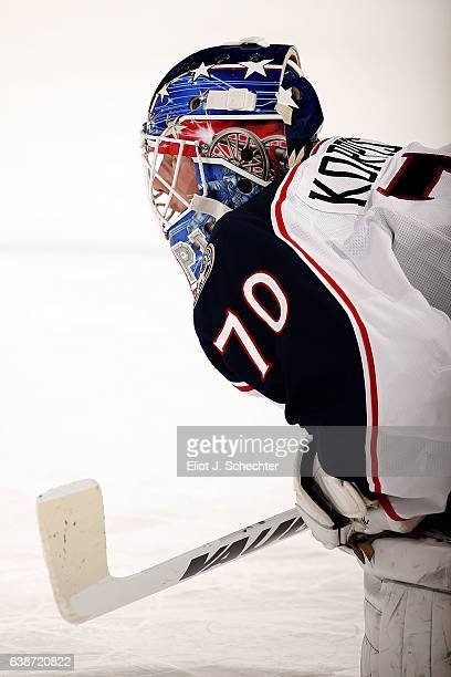 Goaltender Joonas Korpisalo of the Columbus Blue Jackets stretches on the ice during warm ups prior to the start of the game against the Florida...