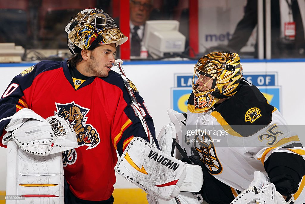 Goaltender Jose Theodore #60 of the Florida Panthers chats with Goaltender Anton Khudobin #35 of the Boston Bruins prior to the start of the game at the BB&T Center on February 24, 2013 in Sunrise, Florida.
