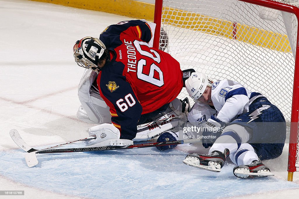 Goaltender Jose Theodore #60 of the Florida Panthers defends the net against <a gi-track='captionPersonalityLinkClicked' href=/galleries/search?phrase=Steven+Stamkos&family=editorial&specificpeople=4047623 ng-click='$event.stopPropagation()'>Steven Stamkos</a> #91 of the Tampa Bay Lightning at the BB&T Center on February 16, 2013 in Sunrise, Florida.