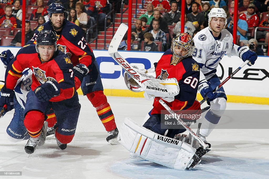 Goaltender Jose Theodore #60 of the Florida Panthers defends the net against Steven Stamkos #91of the Tampa Bay Lightning at the BB&T Center on February 16, 2013 in Sunrise, Florida.