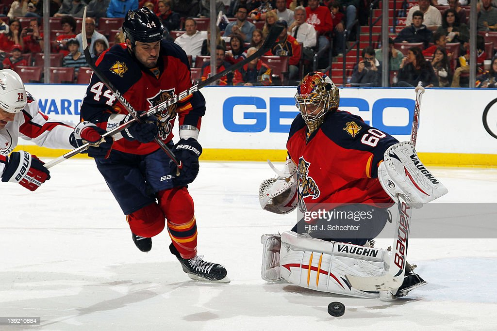 Goaltender Jose Theodore #60 of the Florida Panthers defends the net with the help of teammate <a gi-track='captionPersonalityLinkClicked' href=/galleries/search?phrase=Erik+Gudbranson&family=editorial&specificpeople=5741800 ng-click='$event.stopPropagation()'>Erik Gudbranson</a> #44 at the BankAtlantic Center on February 17, 2012 in Sunrise, Florida.