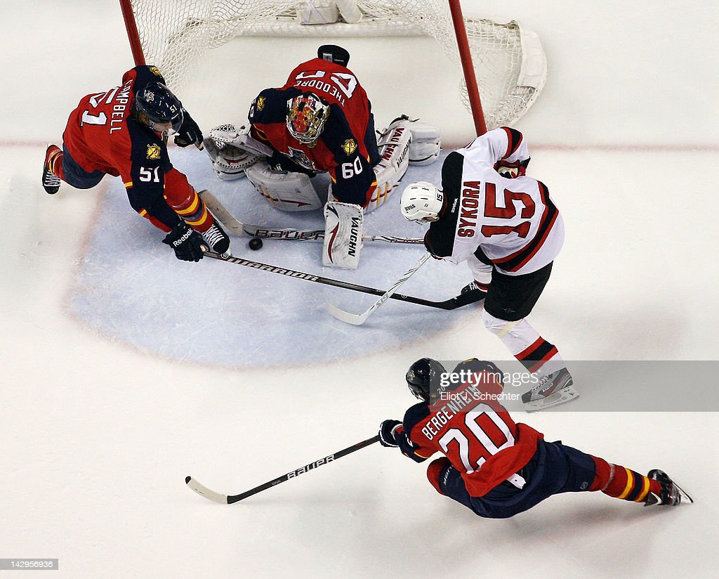 Goaltender <a gi-track='captionPersonalityLinkClicked' href=/galleries/search?phrase=Jose+Theodore&family=editorial&specificpeople=202011 ng-click='$event.stopPropagation()'>Jose Theodore</a> #60 of the Florida Panthers defends the net with the help of teammate <a gi-track='captionPersonalityLinkClicked' href=/galleries/search?phrase=Brian+Campbell+-+Ice+Hockey+Player&family=editorial&specificpeople=209384 ng-click='$event.stopPropagation()'>Brian Campbell</a> #51 against <a gi-track='captionPersonalityLinkClicked' href=/galleries/search?phrase=Petr+Sykora&family=editorial&specificpeople=202186 ng-click='$event.stopPropagation()'>Petr Sykora</a> #15 of the New Jersey Devils in Game Two of the Eastern Conference Quarterfinals during the 2012 NHL Stanley Cup Playoffs at the BankAtlantic Center on April 15, 2012 in Sunrise, Florida.