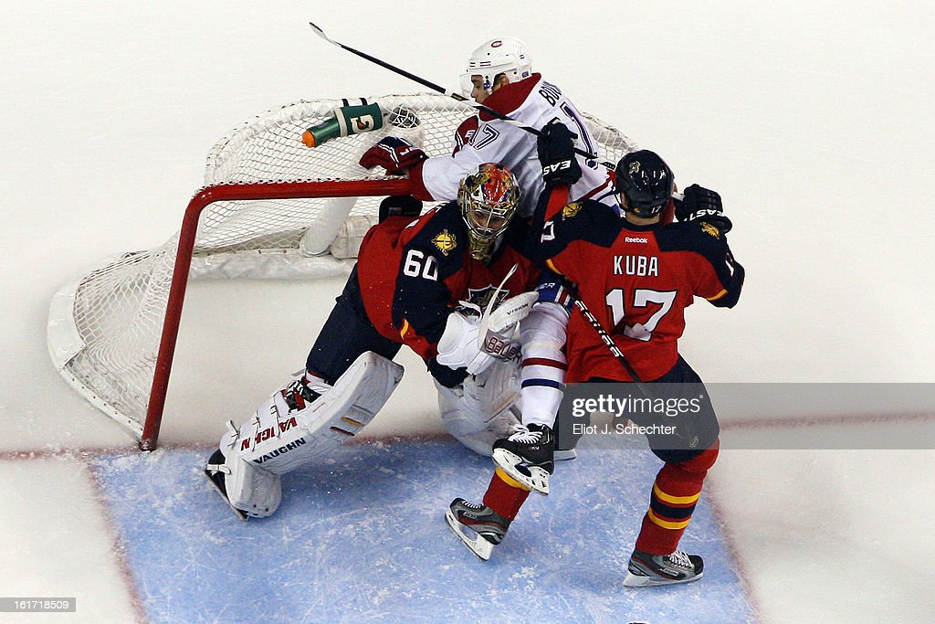 Goaltender <a gi-track='captionPersonalityLinkClicked' href=/galleries/search?phrase=Jose+Theodore&family=editorial&specificpeople=202011 ng-click='$event.stopPropagation()'>Jose Theodore</a> #60 of the Florida Panthers defends the net with the help of teammate <a gi-track='captionPersonalityLinkClicked' href=/galleries/search?phrase=Filip+Kuba&family=editorial&specificpeople=209425 ng-click='$event.stopPropagation()'>Filip Kuba</a> #17 against <a gi-track='captionPersonalityLinkClicked' href=/galleries/search?phrase=Rene+Bourque&family=editorial&specificpeople=685715 ng-click='$event.stopPropagation()'>Rene Bourque</a> #17 of the Montreal Canadiens at the BB&T Center on February 14, 2013 in Sunrise, Florida.