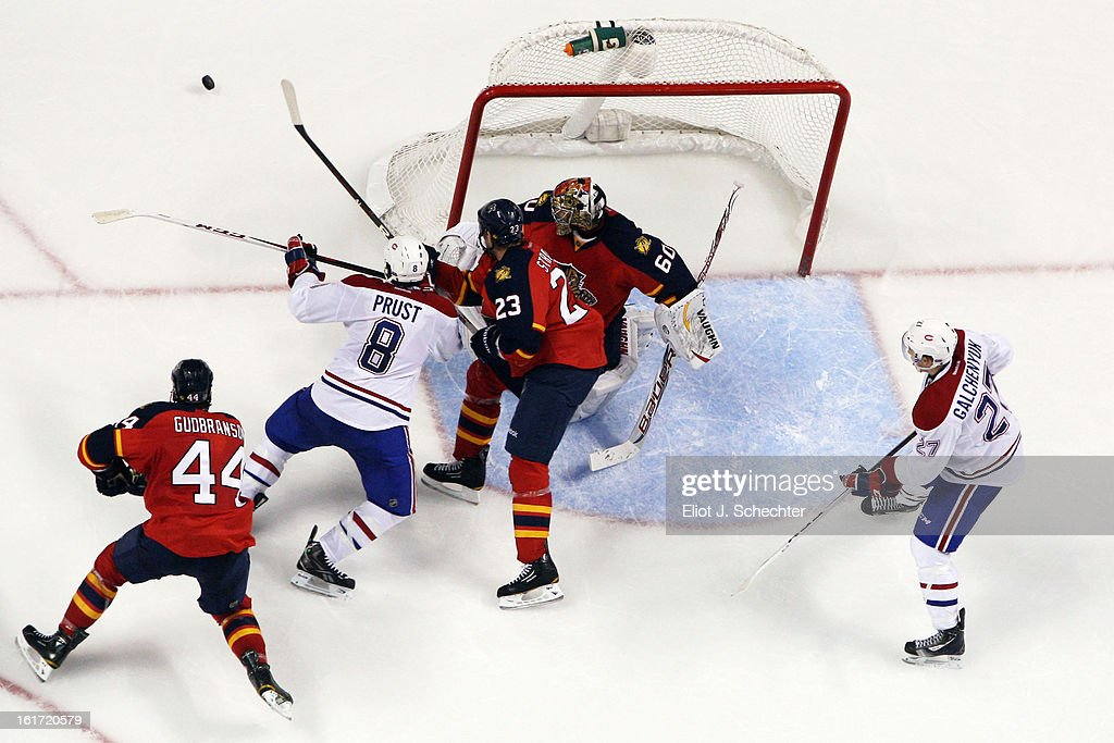 Goaltender <a gi-track='captionPersonalityLinkClicked' href=/galleries/search?phrase=Jose+Theodore&family=editorial&specificpeople=202011 ng-click='$event.stopPropagation()'>Jose Theodore</a> #60 of the Florida Panthers defends the net with help from teammate Tyson Strachan #23 against <a gi-track='captionPersonalityLinkClicked' href=/galleries/search?phrase=Brandon+Prust&family=editorial&specificpeople=2221796 ng-click='$event.stopPropagation()'>Brandon Prust</a> #8 of the Montreal Canadiens at the BB&T Center on February 14, 2013 in Sunrise, Florida.