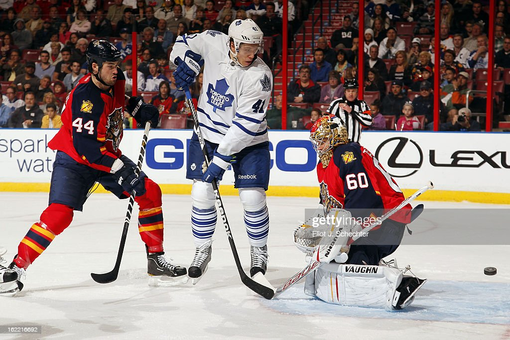 Goaltender Jose Theodore #60 of the Florida Panthers defends the net with the help of teammate Erik Gudbranson #44 against Nikolai Kulemin #41 of the Toronto Maple Leafs at the BB&T Center on February 18, 2013 in Sunrise, Florida.