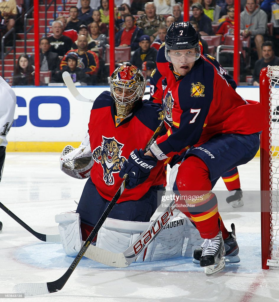 Goaltender Jose Theodore #60 of the Florida Panthers defends the net with the help of teammate Dmitry Kulikov #7 against the Pittsburgh Penguins at the BB&T Center on February 26, 2013 in Sunrise, Florida.