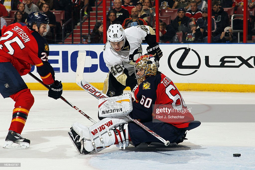 Goaltender Jose Theodore #60 of the Florida Panthers defends the net with the help of teammate Jerred Smithson #25 against Tyler Kennedy #48 of the Pittsburgh Penguins at the BB&T Center on February 26, 2013 in Sunrise, Florida.