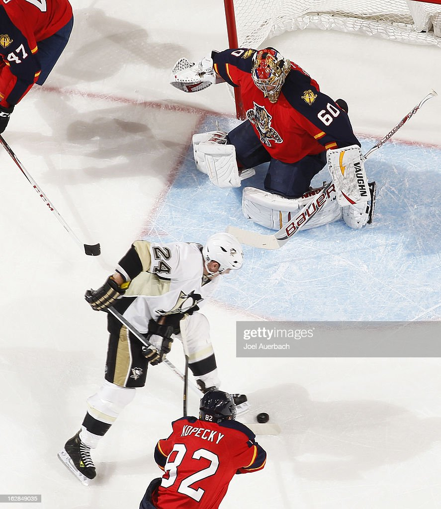 Goaltender Jose Theodore #60 of the Florida Panthers drops down to stop the shot by Matt Cooke #24 of the Pittsburgh Penguins at the BB&T Center on February 26, 2013 in Sunrise, Florida. The Panthers defeated the Penguins 6-4.