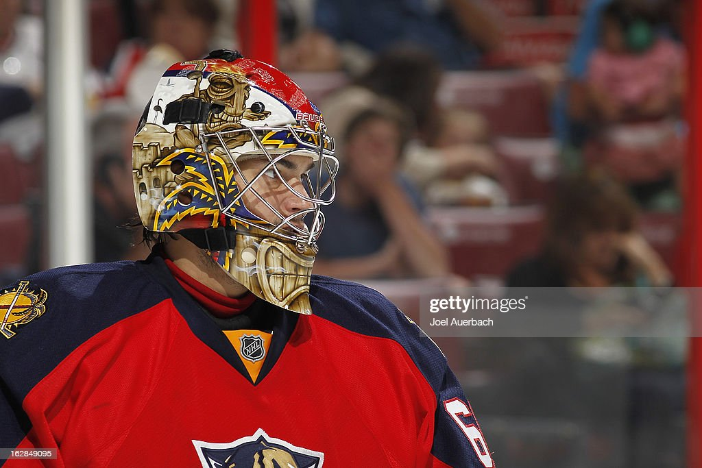 Goaltender Jose Theodore #60 of the Florida Panthers looks up ice during second period action against the Pittsburgh Penguins at the BB&T Center on February 26, 2013 in Sunrise, Florida. The Panthers defeated the Penguins 6-4.