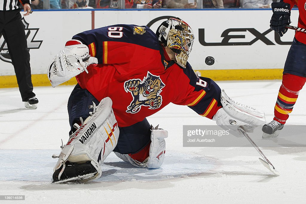 Goaltender <a gi-track='captionPersonalityLinkClicked' href=/galleries/search?phrase=Jose+Theodore&family=editorial&specificpeople=202011 ng-click='$event.stopPropagation()'>Jose Theodore</a> #60 of the Florida Panthers stops a second period shot by the Washington Capitals on February 17, 2012 at the BankAtlantic Center in Sunrise, Florida. The Capitals defeated the Panthers 2-1.