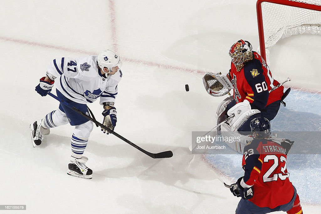Goaltender Jose Theodore #60 of the Florida Panthers stops a shot by Leo Komarov #47 of the Toronto Maple Leafs at the BB&T Center on February 18, 2013 in Sunrise, Florida. The Maple Leafs defeated the Panthers 3-0.