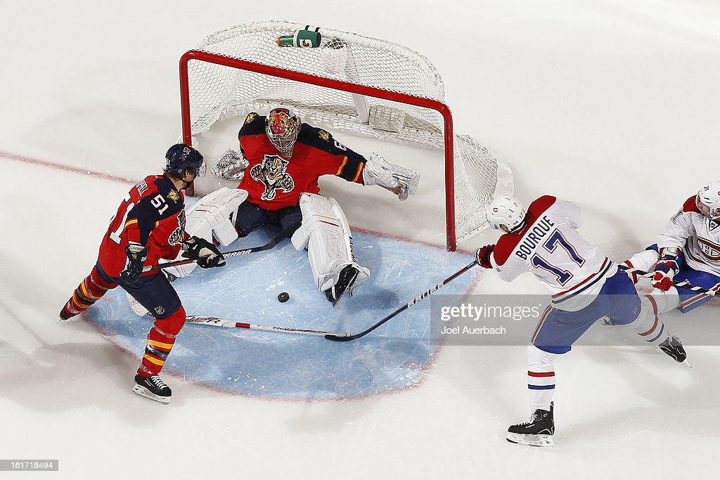 Goaltender <a gi-track='captionPersonalityLinkClicked' href=/galleries/search?phrase=Jose+Theodore&family=editorial&specificpeople=202011 ng-click='$event.stopPropagation()'>Jose Theodore</a> #60 of the Florida Panthers stops a shot by <a gi-track='captionPersonalityLinkClicked' href=/galleries/search?phrase=Rene+Bourque&family=editorial&specificpeople=685715 ng-click='$event.stopPropagation()'>Rene Bourque</a> #17 of the Montreal Canadiens at the BB&T Center on February 14, 2013 in Sunrise, Florida. The Canadiens defeated the Panthers 1-0 in overtime.
