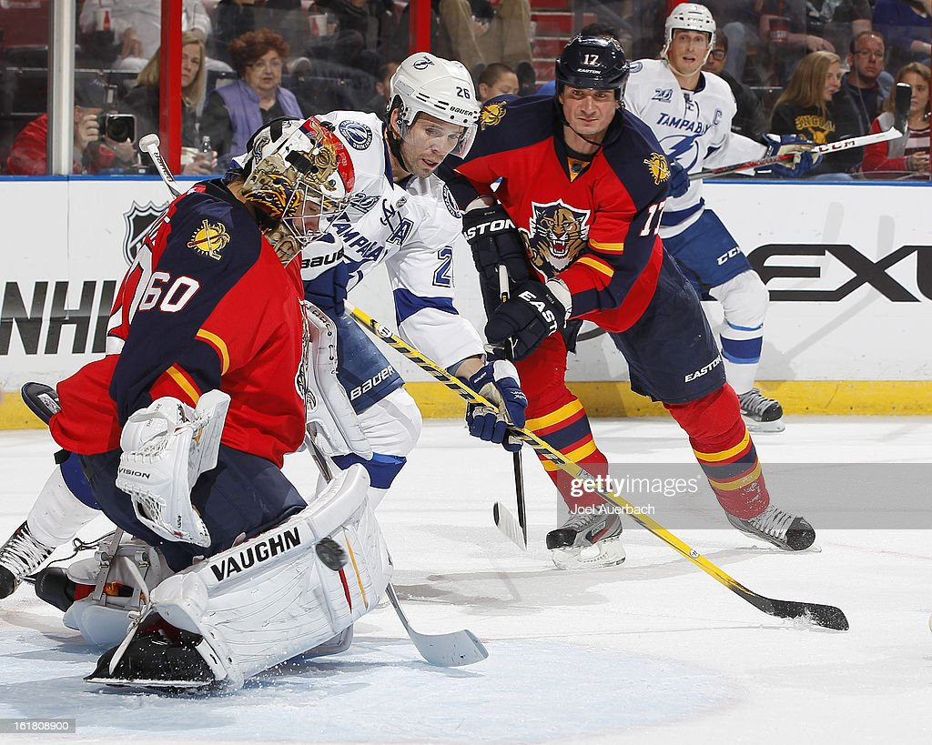 Goaltender Jose Theodore #60 of the Florida Panthers stops a shot by <a gi-track='captionPersonalityLinkClicked' href=/galleries/search?phrase=Martin+St.+Louis&family=editorial&specificpeople=202067 ng-click='$event.stopPropagation()'>Martin St. Louis</a> #26 of the Tampa Bay Lightning at the BB&T Center on February 16, 2013 in Sunrise, Florida. The Lightning defeated the Panthers 6-5 in overtime.