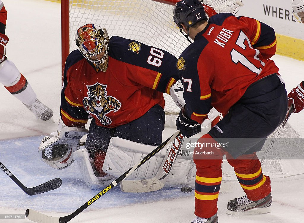 Goaltender Jose Theodore #60 of the Florida Panthers stops a shot by the Carolina Hurricanes during the seasons opener at the BB&T Center on January 19, 2013 in Sunrise, Florida.The Panthers defeated the Hurricanes 5-1.