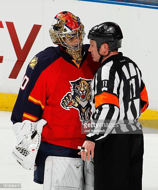 Goaltender Jose Theodore of the Florida Panthers talks to referee Kelly Sutherland during a break in action against the Montreal Canadiens at the BBT...