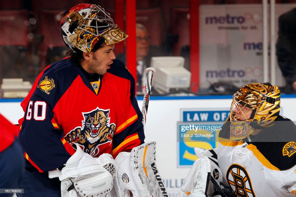 Goaltender Jose Theodore #60 of the Florida Panthers talks with goaltender Anton Khudobin #35 of the Boston Bruins prior to the start of the game at the BB&T Center on February 24, 2013 in Sunrise, Florida.