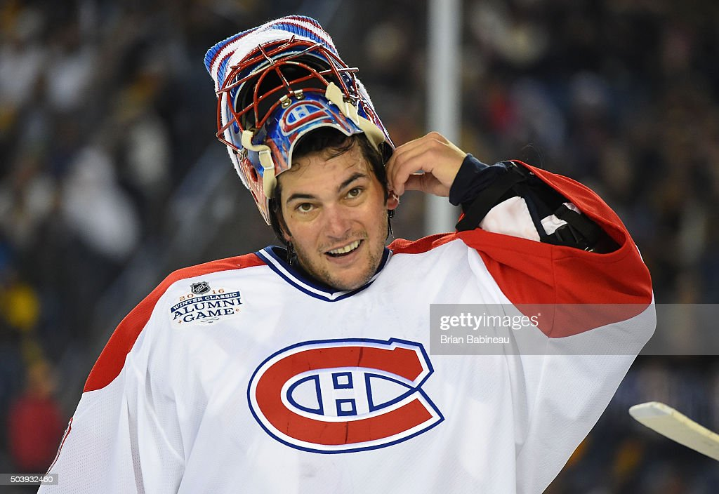 Goaltender Jose Theodore of the Montreal Canadiens Alumni Team adjusts his equipment during the Alumni Game as part of the 2016 Bridgestone NHL...