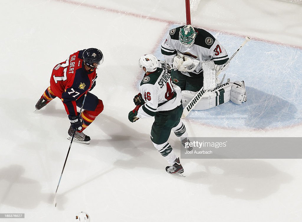 Goaltender <a gi-track='captionPersonalityLinkClicked' href=/galleries/search?phrase=Josh+Harding&family=editorial&specificpeople=700587 ng-click='$event.stopPropagation()'>Josh Harding</a> #37 of the Minnesota Wild stops a shot by <a gi-track='captionPersonalityLinkClicked' href=/galleries/search?phrase=Tom+Gilbert&family=editorial&specificpeople=687083 ng-click='$event.stopPropagation()'>Tom Gilbert</a> #77 of the Florida Panthers at the BB&T Center on October 19, 2013 in Sunrise, Florida. The Panthers defeated the Wild 2-1 in a shoot-out.