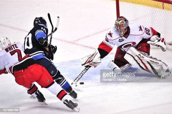 Goaltender Justin Peters of the Carolina Hurricanes defends the net during a NHL game against the Florida Panthers at the BankAtlantic Center on...