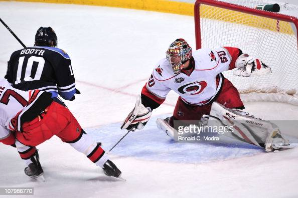 Goaltender Justin Peters of the Carolina Hurricanes defends the net during a a NHL game against the Florida Panthers at the BankAtlantic Center on...