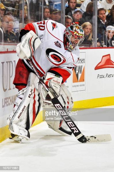 Goaltender Justin Peters of the Carolina Hurricanes handles the puck against the Pittsburgh Penguins on November 19 2010 at Consol Energy Center in...