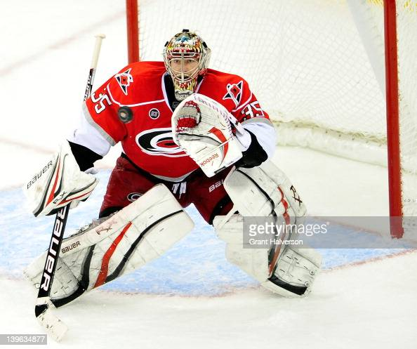 Goaltender Justin Peters of the Carolina Hurricanes stops a shot by the Anaheim Ducks at the RBC Center on February 23 2012 in Raleigh North Carolina