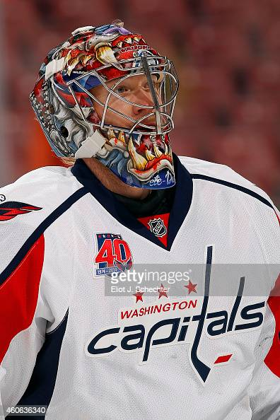 Goaltender Justin Peters of the Washington Capitals warms up on the ice prior to the start of the game against the Florida Panthers at the BBT Center...