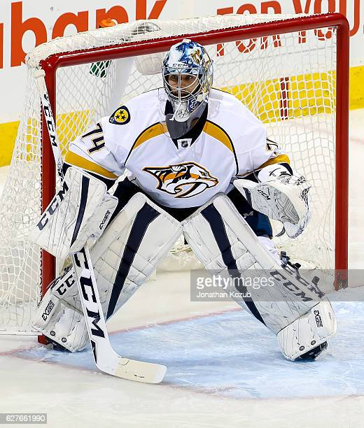 Goaltender Juuse Saros of the Nashville Predators keeps an eye on the play during third period action against the Winnipeg Jets at the MTS Centre on...