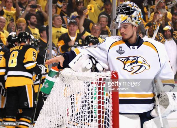 Goaltender Juuse Saros of the Nashville Predators reacts after giving up a goal by Ron Hainsey of the Pittsburgh Penguins during the second period of...