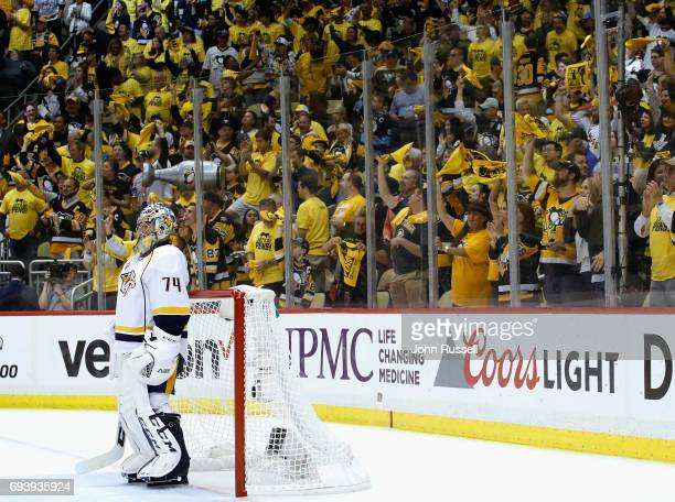 Goaltender Juuse Saros of the Nashville Predators stands on the ice as the crowd celebrates Ron Hainsey's of the Pittsburgh Penguins goal during the...