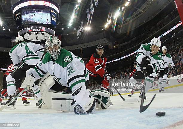 Goaltender Kari Lehtonen and Cody Eakin of the Dallas Stars defend against Reid Boucher of the New Jersey Devils during the second period at the...