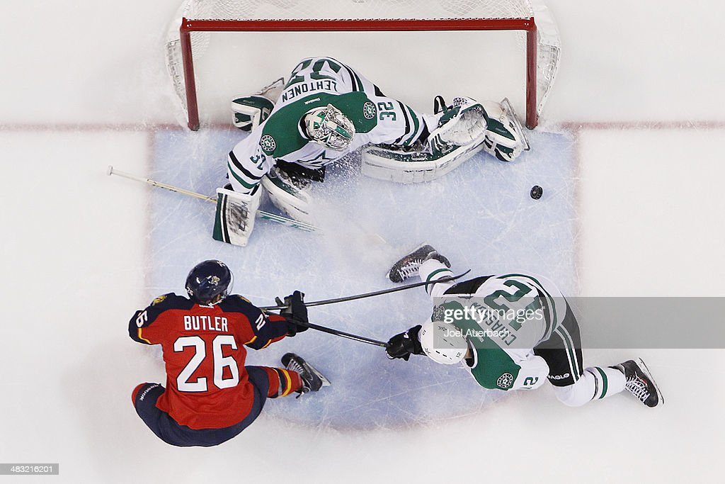 Goaltender Kari Lehtonen of the Dallas Stars defends against the shot by Bobby Butler of the Florida Panthers at the BBT Center on April 6 2014 in...