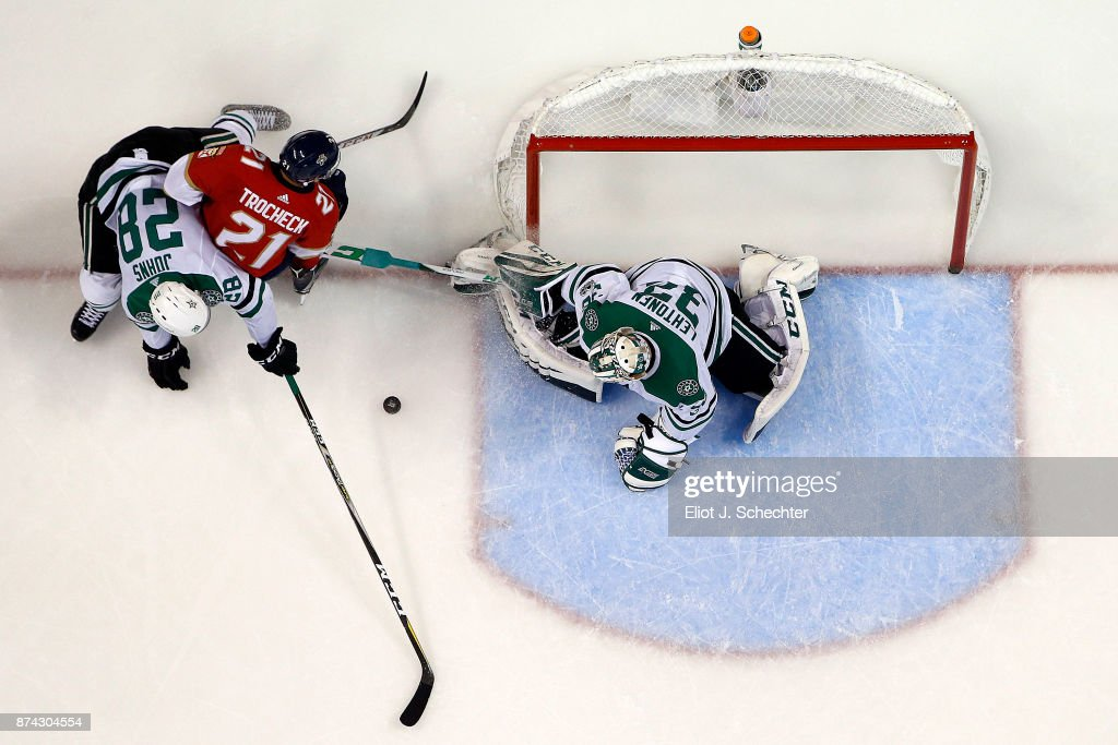 Goaltender Kari Lehtonen #32 of the Dallas Stars defends the net with the help of teammate Stephen Johns #28 against Vincent Trocheck #21 of the Florida Panthers at the BB&T Center on November 14, 2017 in Sunrise, Florida.