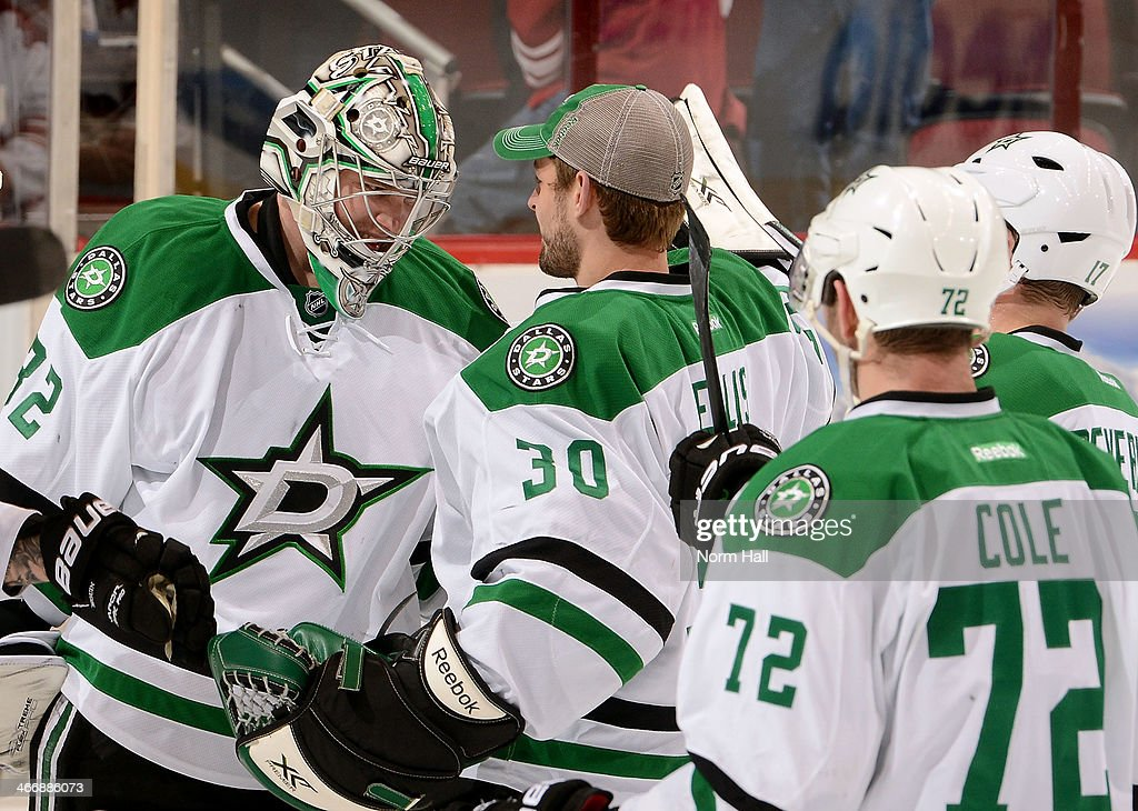 Goaltender Kari Lehtonen #32 of the Dallas Stars is congratulated by teammates Dan Ellis #30, Erik Cole #72 and Alex Chiasson #12 after a 3-1 victory over the Phoenix Coyotes at Jobing.com Arena on February 4, 2014 in Glendale, Arizona.