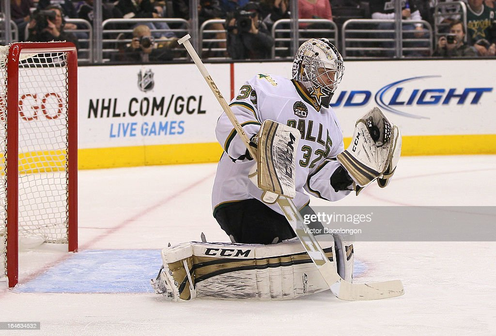 Goaltender <a gi-track='captionPersonalityLinkClicked' href=/galleries/search?phrase=Kari+Lehtonen&family=editorial&specificpeople=211612 ng-click='$event.stopPropagation()'>Kari Lehtonen</a> #32 of the Dallas Stars makes a glove save in the second period during the NHL game against the Los Angeles Kings at Staples Center on March 21, 2013 in Los Angeles, California. The Stars defeated the Kings 2-0.