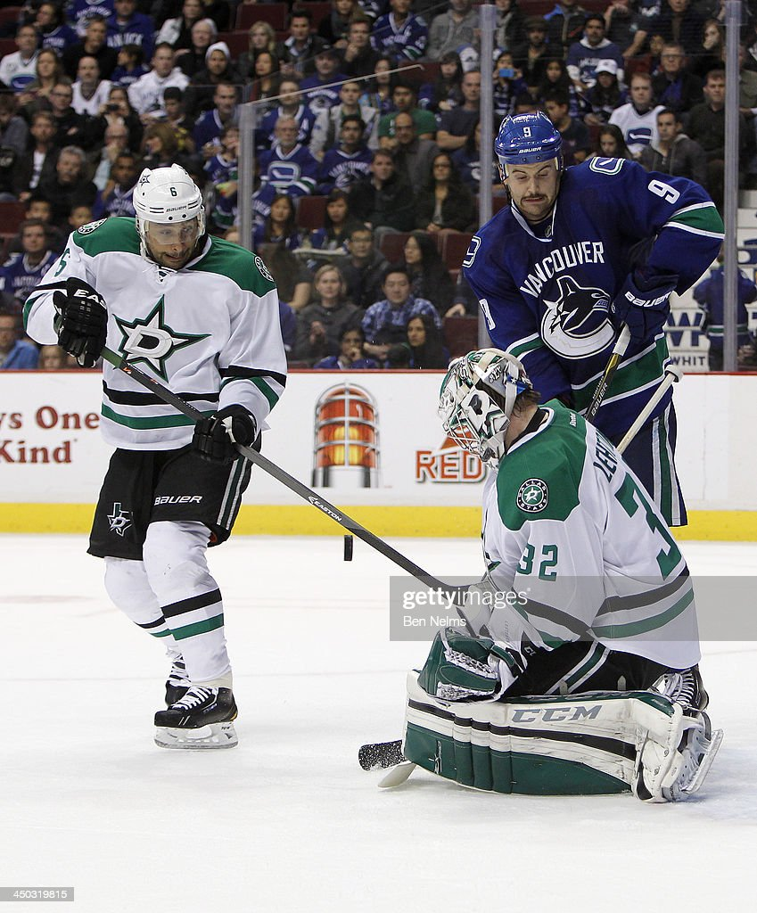 Goaltender <a gi-track='captionPersonalityLinkClicked' href=/galleries/search?phrase=Kari+Lehtonen&family=editorial&specificpeople=211612 ng-click='$event.stopPropagation()'>Kari Lehtonen</a> #32 of the Dallas Stars makes a save in front of <a gi-track='captionPersonalityLinkClicked' href=/galleries/search?phrase=Trevor+Daley&family=editorial&specificpeople=213975 ng-click='$event.stopPropagation()'>Trevor Daley</a> #6 of the Dallas Stars and <a gi-track='captionPersonalityLinkClicked' href=/galleries/search?phrase=Zack+Kassian&family=editorial&specificpeople=4604939 ng-click='$event.stopPropagation()'>Zack Kassian</a> #9 of the Vancouver Canucks during the third period of their NHL game at Rogers Arena on November 17, 2013 in Vancouver, British Columbia, Canada.