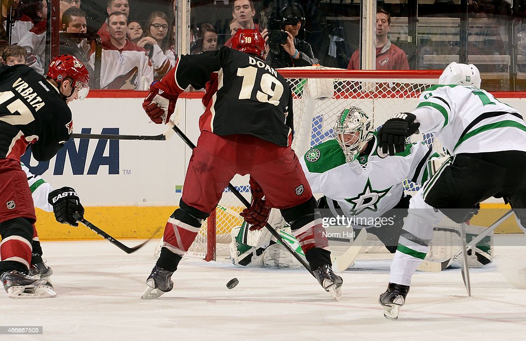 Goaltender Kari Lehtonen #32 of the Dallas Stars makes a save on the shot by Radim Vrbata #17 of the Phoenix Coyotes as Shane Doan #19 of the Coyotes looks for a rebound during the first period at Jobing.com Arena on February 4, 2014 in Glendale, Arizona.