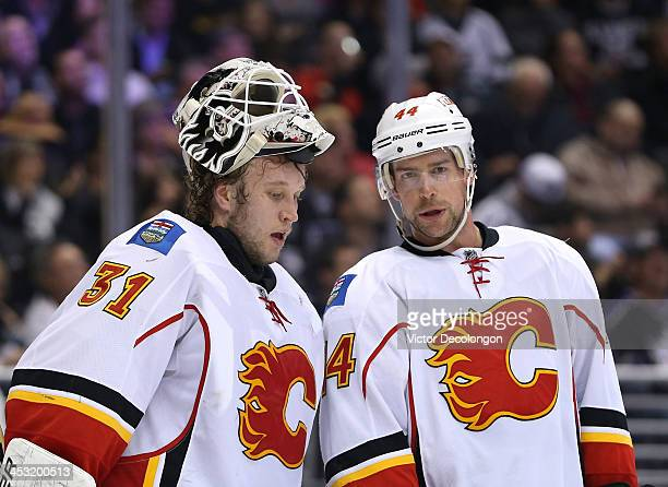 Goaltender Karri Ramo and Chris Butler of the Calgary Flames confer during a break in NHL game action in the second period against the Los Angeles...