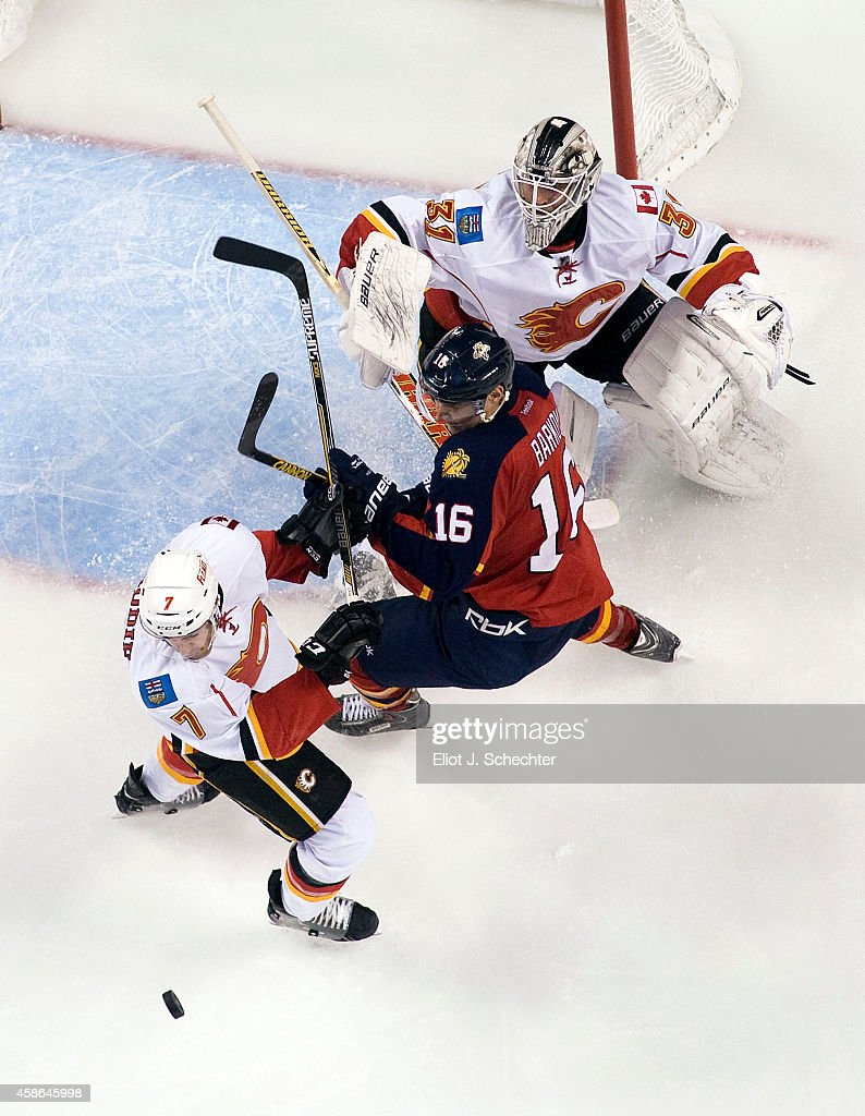 Goaltender Karri Ramo #31 of the Calgary Flames defends the net with the help of teammate T.J. Brodie #7 against Aleksander Barkov #16 of the Florida Panthers at the BB&T Center on November 8, 2014 in Sunrise, Florida.