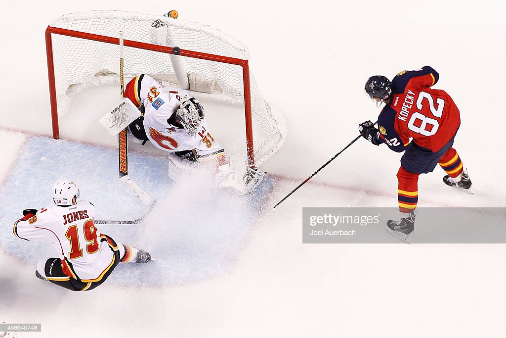Goaltender Karri Ramo #31 of the Calgary Flames deflects the puck shot by Tomas Kopecky #82 of the Florida Panthers over the net during second period action at the BB&T Center on November 8, 2014 in Sunrise, Florida. The Flames defeated the Panthers 6-4.