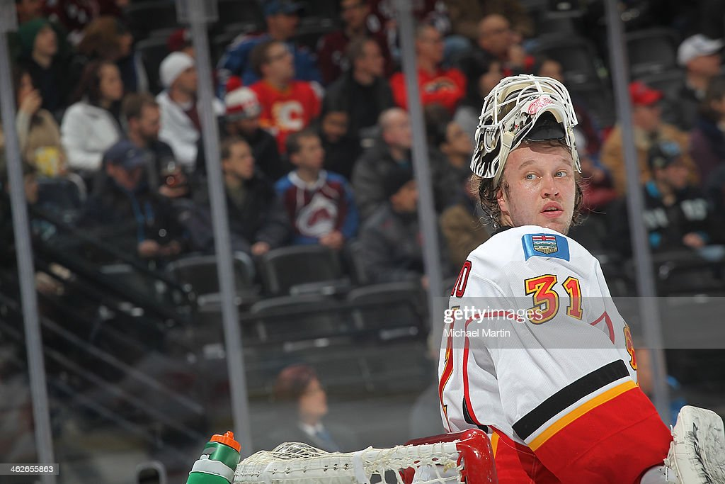 Goaltender Karri Ramo #31 of the Calgary Flames looks on during a time out against the Colorado Avalanche at the Pepsi Center on January 06, 2014 in Denver, Colorado. The Flames defeated the Avalanche 4-3.