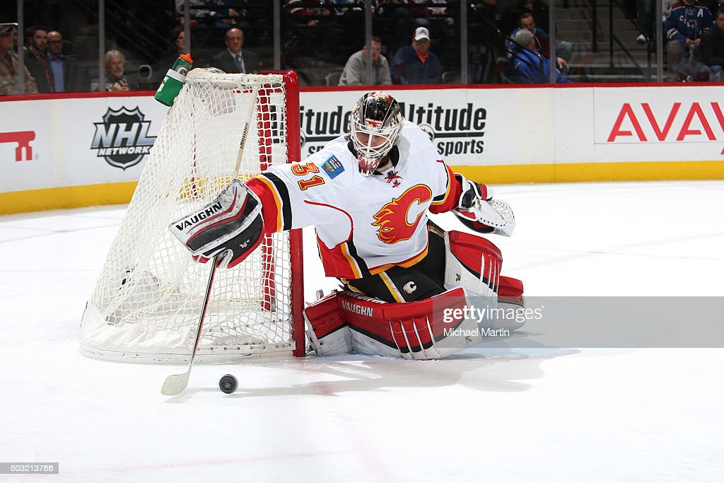 Goaltender Karri Ramo #31 of the Calgary Flames reaches for the puck during the game against the Colorado Avalanche at the Pepsi Center on January 2, 2016 in Denver, Colorado. The Flames defeated the Avalanche 4-0.