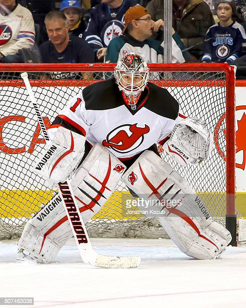 Goaltender Keith Kincaid of the New Jersey Devils takes part in the pregame warm up prior to NHL action against the Winnipeg Jets at the MTS Centre...