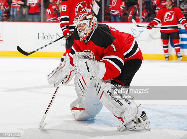 Goaltender Keith Kinkaid of the New Jersey Devils defends the net during pregame warmups prior to the game against the New York Islanders at the...