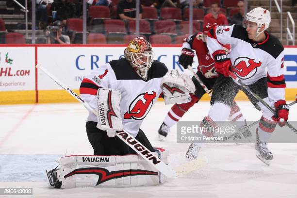 Goaltender Keith Kinkaid of the New Jersey Devils in ation during the NHL game against the Arizona Coyotes at Gila River Arena on December 2 2017 in...