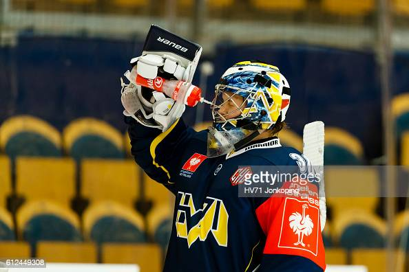 Goaltender Linus Soderstrom of HV71 Jonkoping sprays his face with water during the Champions Hockey League Round of 32 match between HV71 Jonkoping...